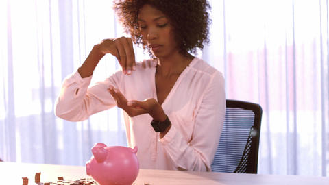 Businesswoman counting coin in office Live Action