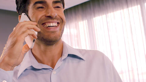 Businessman talking on mobile phone in office Footage
