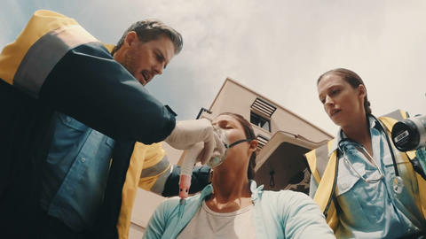 Doctor putting an oxygen mask on patient Live Action