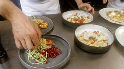 Mid-section of chefs garnishing food Footage