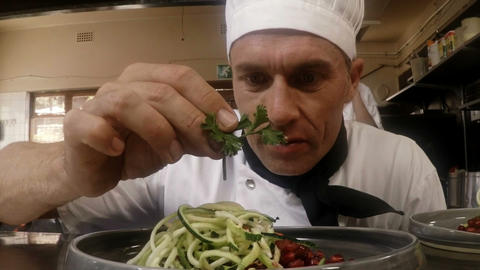 Male chef garnishing food Footage