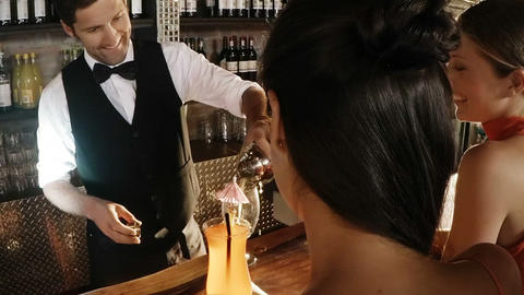 Waiter pouring cocktail in glass Live Action