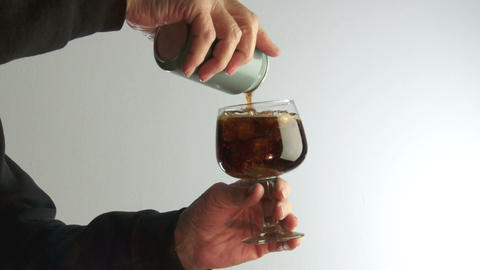 male hands pour cola or coke into a glass Footage