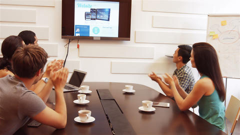 Business executive applauding during a video conference Footage