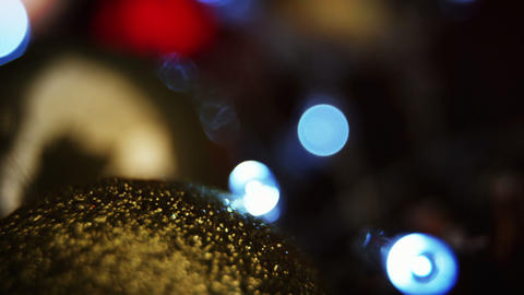 Close-up of christmas bauble with christmas lights Footage