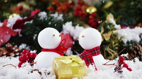 Two snowman with fake snow Footage