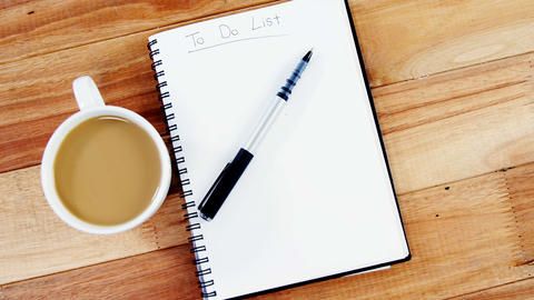 Cup of coffee with diary and pen Live Action