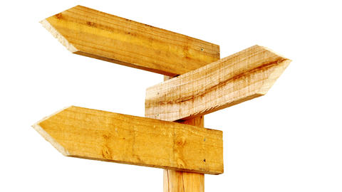 Wooden arrow direction sign post Live Action