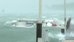 typhoon conditions - close up boat damaged by storm surge Footage
