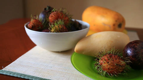 Exotic tropical fruit on table. Thai fruit. close-up Live Action