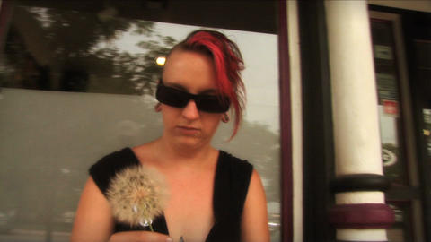 (1107) Tattooed young woman with Mohawk making dandelion... Stock Video Footage