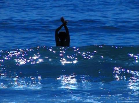 Bikini Girl 02 Playing in ocean waves Footage
