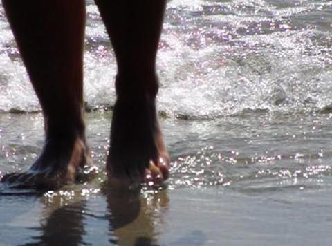 Girl jumps on ocean waves Stock Video Footage