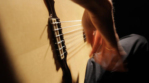 A close up of a guitarist shot being play flamenco Stock Video Footage