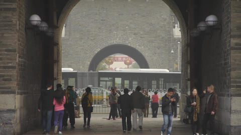 tourist pass ancient city gate tower & arch in beijing china Footage