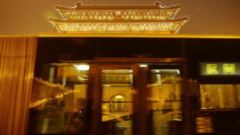 Beijing ancient building night scene & busy traffic Stock Video Footage