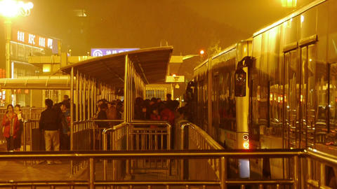 bus station & waiting crowd in Beijing at night Stock Video Footage
