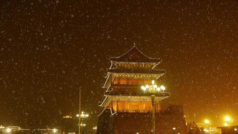 Beijing ancient building night scene & busy traffic,falling snow Footage