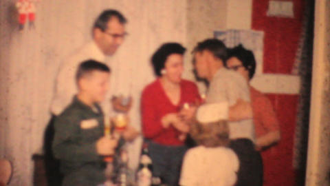 Family Celebrating New Years 1964 Vintage 8mm film Stock Video Footage