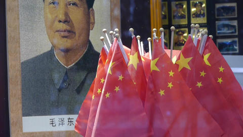 Portrait Of Mao Zedong & China National-flag In St stock footage