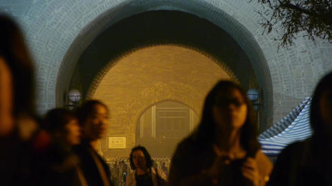 night scene crowd & busy traffic in beijing,ancient city gate tower & ar Footage