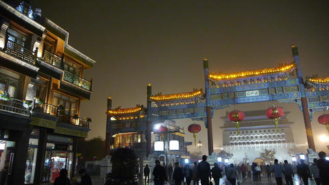 timelapse crowd walk in China Beijing night market,memorial arch & lantern Footage