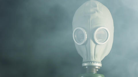 A Man In A Gas Mask And Smoke stock footage