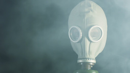 A man in a gas mask and smoke Stock Video Footage