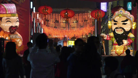 crowd walk on China night street market,cartoon characters Stock Video Footage
