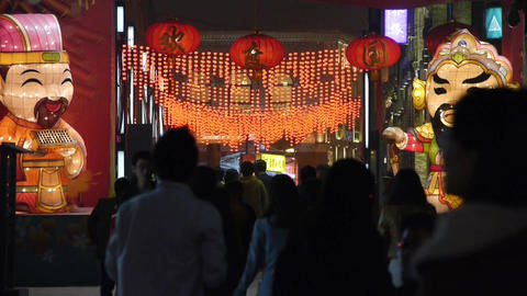 crowd walk on China night street market,cartoon characters Stock Video Footage