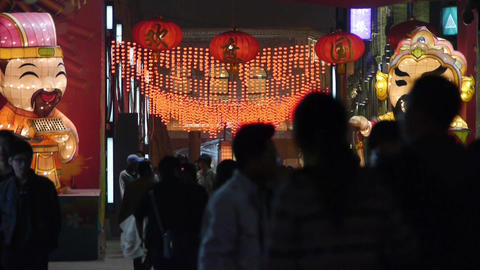 crowd walk on China night street market,cartoon characters Footage