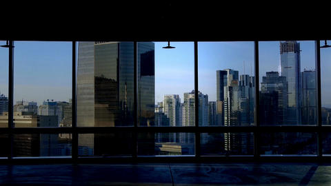 view modern urban architecture from building window in Beijing,sun pass through  Footage