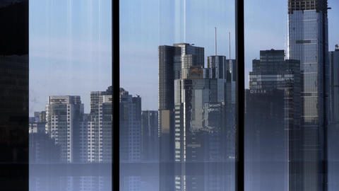 view modern urban high-rise from windows,business financial center Footage