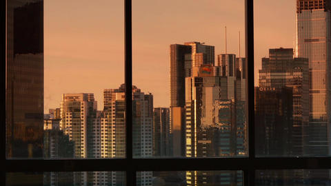 view modern urban high-rise from windows in dusk,business... Stock Video Footage