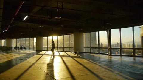 a tired man walking in business building inside platform,sunset rays light pass  Footage