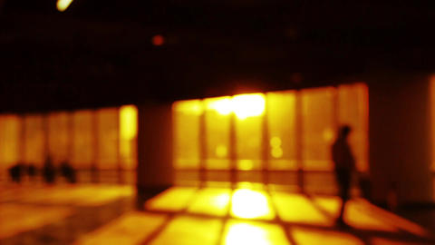 blur backgrounds of a person walking in business building inside platform,sunset Footage