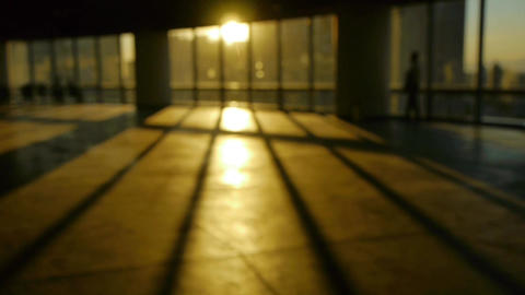 Blur Backgrounds Of A Person Walking In Business Building Inside Platform,sunset Rays Light Pass Win stock footage