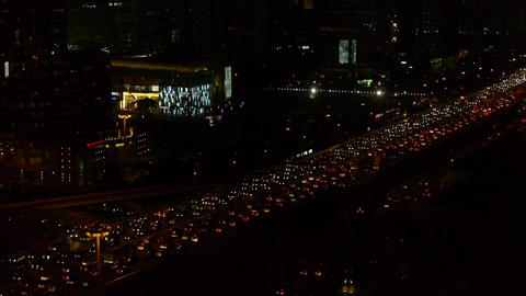 many cars slow moving on overpass,nighttime traffic jam in Beijing Footage