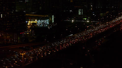 many cars slow moving on overpass,nighttime traffic jam... Stock Video Footage