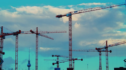 Timelapse of working cranes and cloudy sky Stock Video Footage
