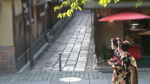 Geishas walking in Kyoto Stock Video Footage
