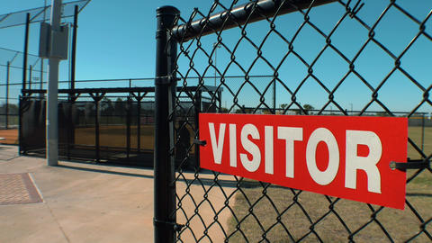 """Visitor"" Sign on Fence of Baseball FIeld Dugout, 4K Footage"