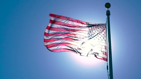 American Flag Illuminated by Sun Waving in WInd, 4K Archivo