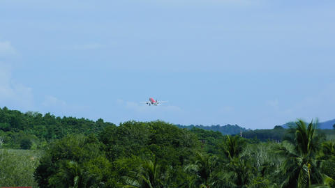 Take off airplane over tropical forest Footage