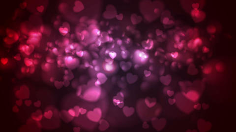Red and pink glowing bokeh hearts video animation Animation