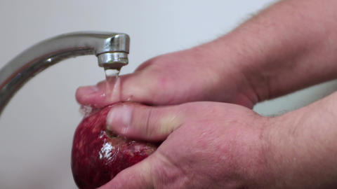 Men's hands wash burgundy garnet with fingers with a quick movement Live Action