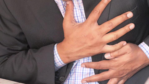 business suffering pain in heart and holding chest with hand Live Action