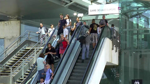 Commuting passengers at Gare de Lille Europe Station Live Action