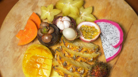 exotic fruits on the table. 4k, top view, slow motion. carambola and dragon Live Action