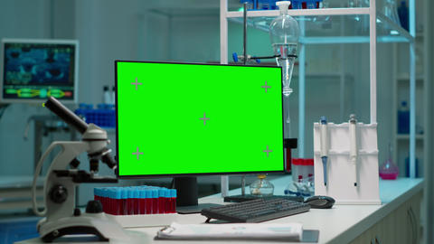 Desktop computer with green screen, mock up on display placed on desk Live Action